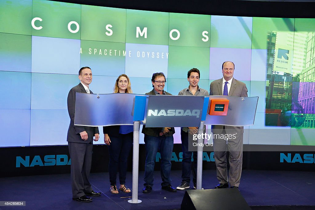 A SpaceTime Odyssey associate producer Joseph J. Micucci (2nd R) and NASDAQ Vice President, David Wicks (R) attend as Cosmos: A SpaceTime Odyssey co-executive producer Jason Clark (C) rings the closing bell at the NASDAQ MarketSite on August 27, 2014 in New York City.
