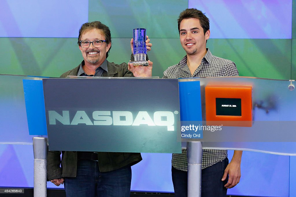 A SpaceTime Odyssey associate producer Joseph J. Micucci (R)attends as Cosmos: A SpaceTime Odyssey co-executive producer Jason Clark (C) rings the closing bell at the NASDAQ MarketSite on August 27, 2014 in New York City.