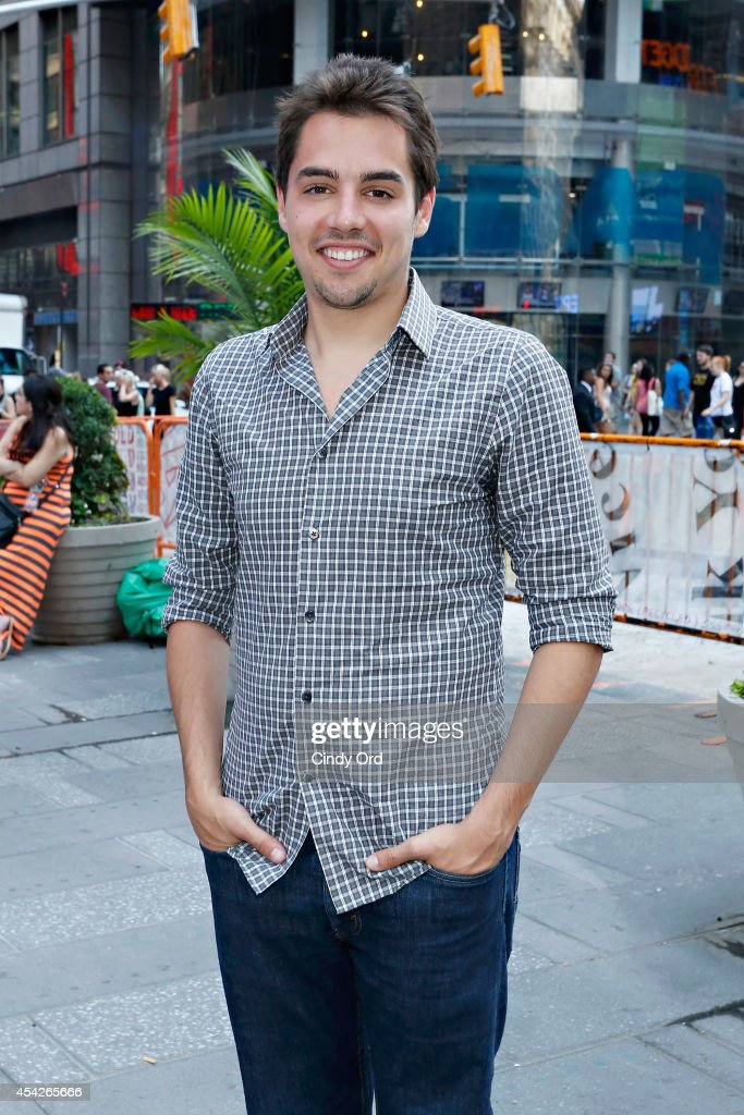 A SpaceTime Odyssey associate producer Joseph J. Micucci attends as Cosmos: A SpaceTime Odyssey co-executive producer Jason Clark rings the closing bell at the NASDAQ MarketSite on August 27, 2014 in New York City.