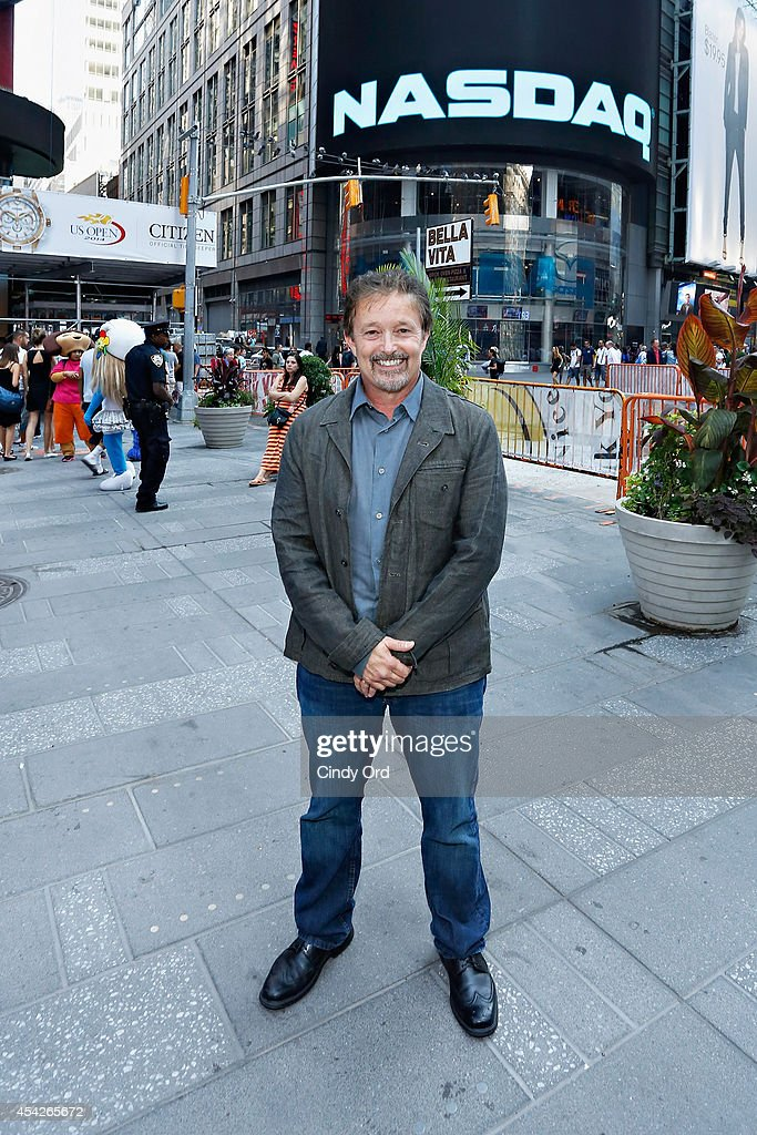 A SpaceTime Odyssey co-executive producer Jason Clark poses for a photo after ringing the closing bell at the NASDAQ MarketSite on August 27, 2014 in New York City.