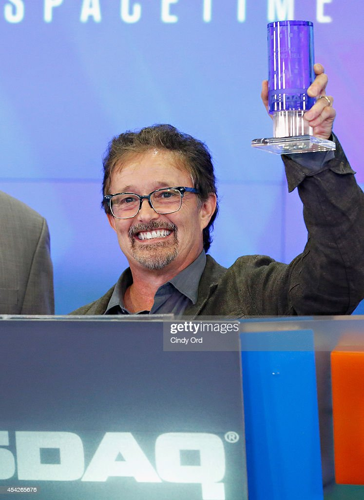 A SpaceTime Odyssey co-executive producer Jason Clark rings the closing bell at the NASDAQ MarketSite on August 27, 2014 in New York City.