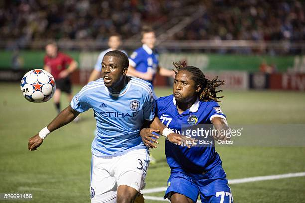 NY Cosmos player Lucky Mkosana fights for control of the ball against New York City FC player Kwame WatsonSiriboe the Soccer 2015 Lamar Hunt US Open...