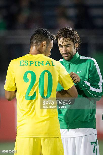 NY Cosmos player Raul ] signs the jersey of Tampa Bay Rowdies player Darwin Espinal after the Soccer 2015 NASL NY Cosmos vs Tampa Bay Rowdies match...