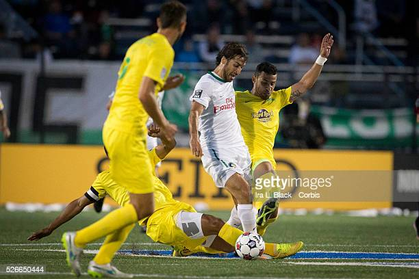 NY Cosmos player Raul surrounded by a sea of yellow and Tampa Bay Rowdies during the Soccer 2015 NASL NY Cosmos vs Tampa Bay Rowdies match on April...