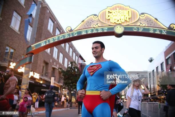 Cosplay character dressed as Superman poses for pictures along 5th Avenue in the Gaslamp Quarter during Comic Con International on July 20 2017 in...