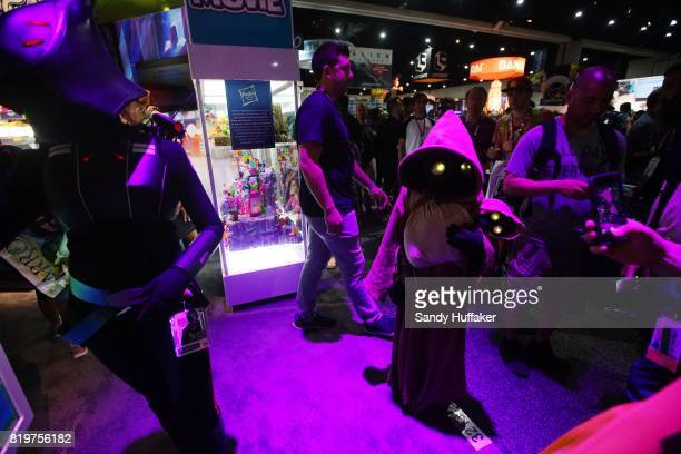 Cosplay charactors mingle on the trade floor during Comic Con International on July 20 2017 in San Diego California Comic Con International is North...