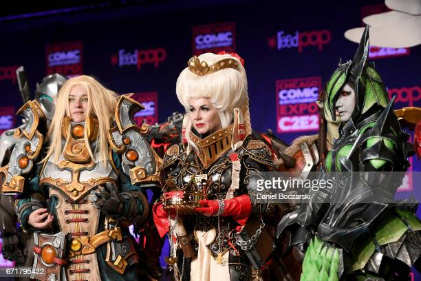 """Cosplay contest winners dressed as a Blood Elf Priest from """"World of Warcraft,"""" a Ordo Hereticus Inquisitor from """"Warhammer 40k"""" attend a Monster..."""
