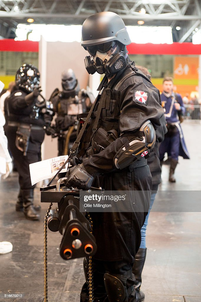 A cosplay enthusiast attending as a Umbrella Corporation soldier from the Resident Evil series on the 2nd day of Comic Con 2016 on March 20, 2016 in Birmingham, United Kingdom.