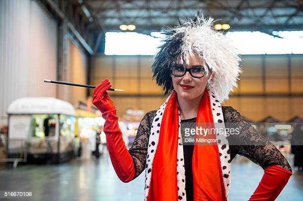 A cosplay enthusiast attending as Cruella de Vil from 101 Dalmations on the 2nd day of Comic Con 2016 on March 20 2016 in Birmingham United Kingdom