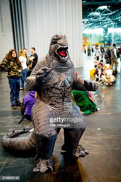 Cosplay enthusiast attending as Godzilla on the 2nd day of Comic Con 2016 on March 20 2016 in Birmingham United Kingdom