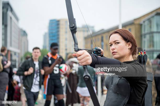 A cosplay enthusiast dressed as Katniss Everdeen from The Hunger Games on Day 2 of MCM London Comic Con at The London ExCel on May 28 2016 in London...