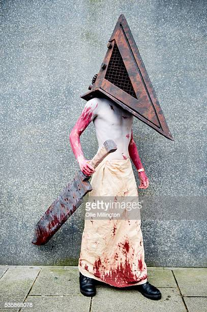 A cosplay enthusiast dressed as Pyramid Head from Silent Hill on Day 2 of MCM London Comic Con at The London ExCel on May 28 2016 in London England