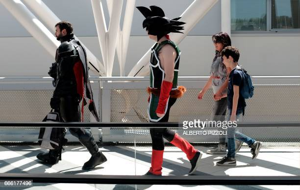A cosplay enthusiast dressed up as a caracter of the japanese manga Dragon Ball Z walks by the venue of the Romics event a comic book and gaming...