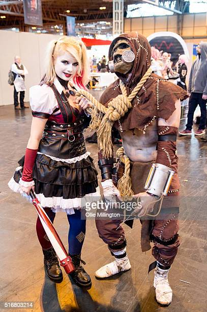 Cosplay enthusiasts attending as Harley Quinn and Scarecrow on the 2nd day of Comic Con 2016 on March 20 2016 in Birmingham United Kingdom
