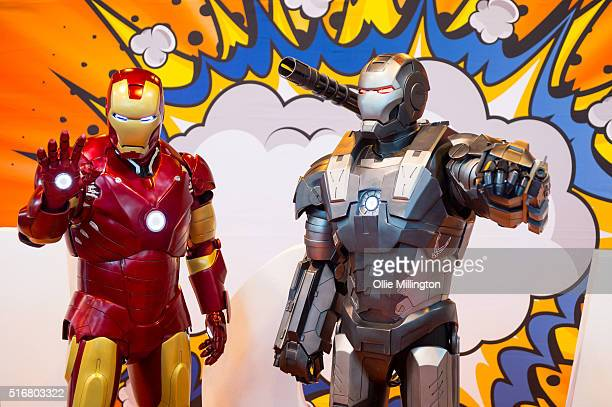 Cosplay enthusiasts attending in character as Iron Man and War Machine on the 2nd day of Comic Con 2016 on March 20 2016 in Birmingham United Kingdom