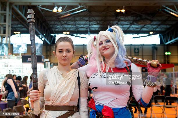 Cosplay enthusiasts attending in character as Rey from Star Wars The Force Awakens and Harley Quinn on her on March 20 2016 in Birmingham United...