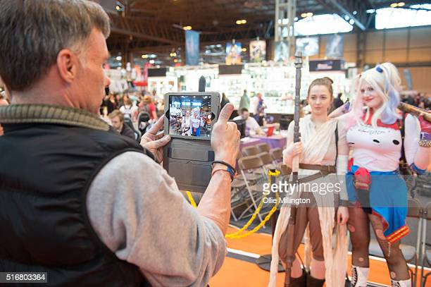 Cosplay enthusiasts attending in character as Rey from Star Wars The Force Awakens and Harley Quinn have their photograph taken on her on March 20...