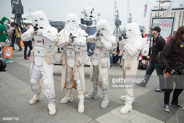 Cosplay enthusiasts dressed as Star Wars Storm Troopers on Day 2 of MCM London Comic Con at The London ExCel on May 28 2016 in London England