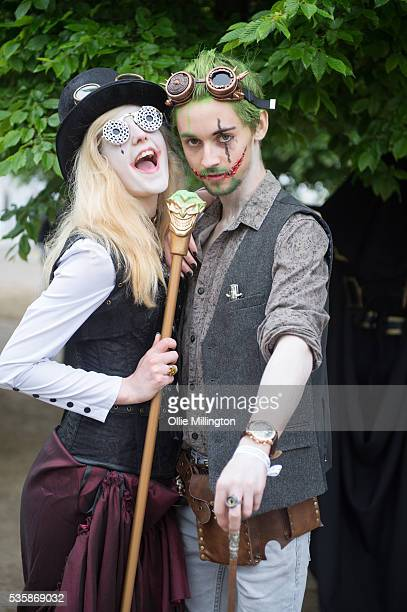 Cosplay enthusiasts dressed as The Joker and Harley Quinn on day 2 at The London ExCel on May 28 2016 in London England