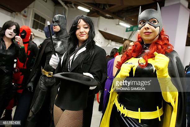 A cosplay fan dressed as batgirl poses as she takes part in a contest with other fans on November 24 2013 during the Paris Comics Expo at the Espace...