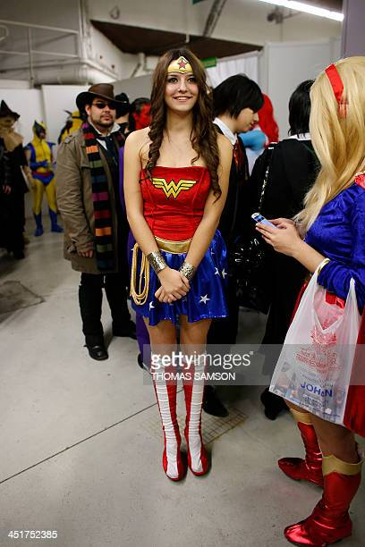 A cosplay fan dressed as Wonderwoman poses during a contest on November 24 2013 during the 'Paris Comics Expo' at the Espace Champerret in Paris...