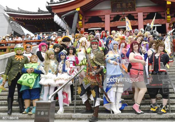 'Cosplay' fans dressed in costumes of their favorite anime and manga characters gather and pose for photos in Nagoya on Aug 6 during a parade as part...