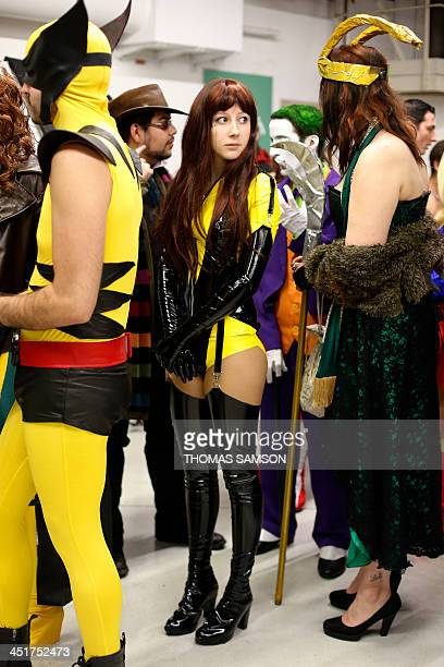 Cosplay fans line up as they take part in a contest on November 24 2013 during the 'Paris Comics Expo' at the Espace Champerret in Paris Organised by...