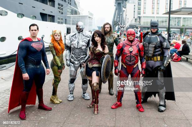 A cosplay group seen in character as Batman Aquaman Mera Wonder Woman The Flash and Cyborg from The Justice League on Day 3 of of the MCM London...