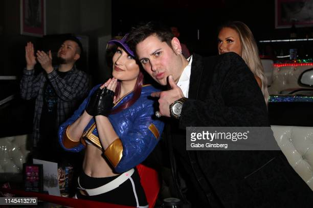 Cosplay model Holly Wolf and producer Dave Bryant attend Larry Flynt's Hustler Club The Gamer Convention celebration at Larry Flynt's Hustler Club on...