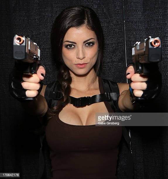 Cosplay model LeeAnna Vamp dressed as the character Lara Croft from the Tomb Raider video game franchise attends the Amazing Las Vegas Comic Con at...