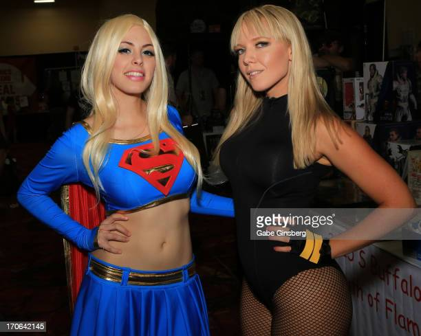 Cosplay model Nadya Anton dressed as the character Supergirl from the 'Superman' comic book franchise and Toni Darling dressed as the character Black...