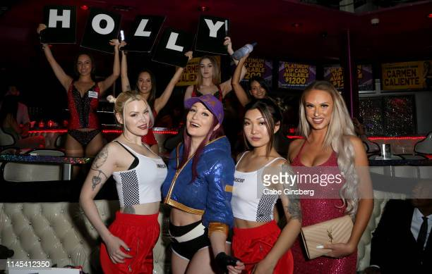 Cosplay models Dangrrr Doll Holly Wolf Gaius Cosplay and Eden Victoria attend Larry Flynt's Hustler Club The Gamer Convention celebration at Larry...