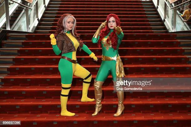 Cosplay or costume play actors Eclectic Eevee and Sweet Spectre dress as characters from the XMen comic books during the first day of Awesome Con at...