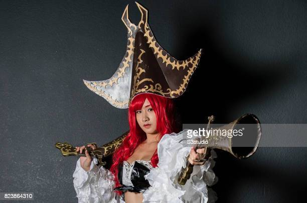 A cosplay participant dresses as Miss Fortune of 'league of legends' at the 19th AniCom and Games Fair 2017 at the Hong Kong Convention and...