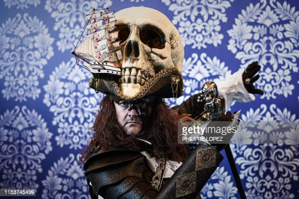 Cosplay participant wearing a hat made with a fake skull and a boat poses for a photo during the 2019 Japan Expo exhibition in Villepinte, near...