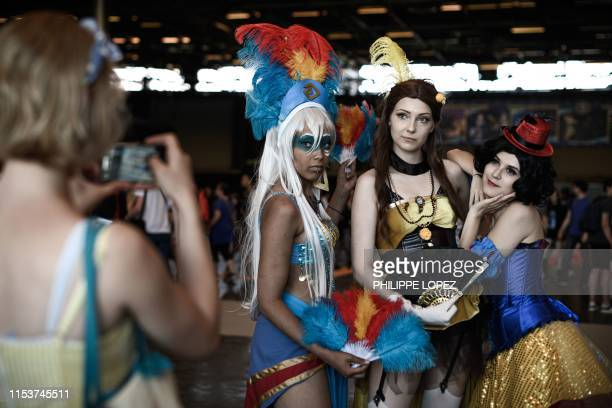 Cosplay participants pose for a picture during the 2019 Japan Expo exhibition in Villepinte, near Paris, on July 4, 2019. - Japan Expo, the largest...