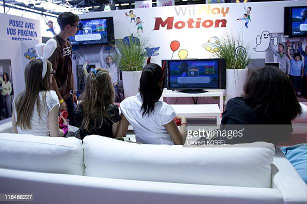 Cosplay playing Wii during the Japan Expo Festival on July 3 2011 in Villepinte France