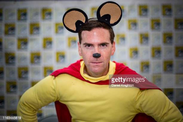 Cosplayer Austin Hartman as Mighty Mouse poses at 2019 ComicCon International on July 21 2019 in San Diego California