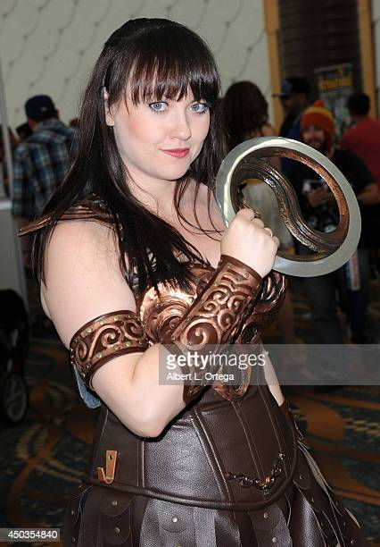 Cosplayer Bernadette Bentley dressed as a Xena attends the 2014 Long Beach Comic Expo at the Long Beach Convention Center on May 31 2014 in Long...