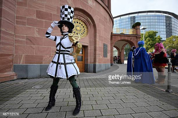 'Cosplayer' Celina pose in the role of 'Alice Madness Returns Hattres' at the Frankfurt Book Fair on October 12 2014 in Frankfurt am Main Germany...