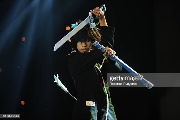 A cosplayer contestant performs in Grand Final Cosplay Clash Competition on June 21 2014 in Jakarta Indonesia Clash is the Indonesian national...