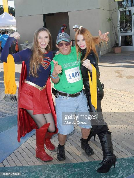 Cosplayer Darth Lexii and actress Ainsley Ross pose with a participant at Easter Seals Southern California's 'Strides For Disability 5K Run/Walk and...