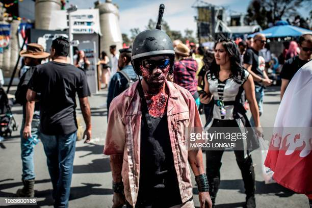 TOPSHOT A cosplayer dressed as a zombie is seen at the fisrt ever multigenre entertainment comic and fan convention Comicon Africa in Johannesburg on...