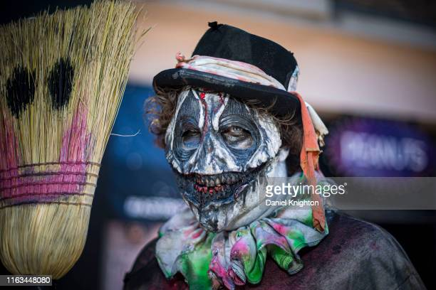 Cosplayer dressed as an evil clown poses outside 2019 Comic-Con International on July 21, 2019 in San Diego, California.