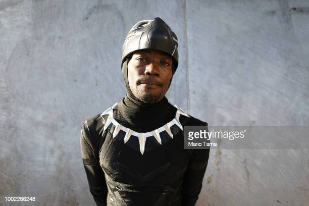 A cosplayer dressed as Black Panther poses outside San Diego ComicCon on July 19 2018 in San Diego California Thousands of revelers are arriving for...