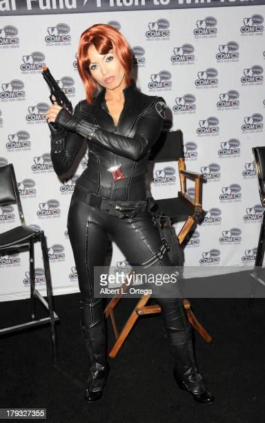 Cosplayer dressed as Black Widow attends Day 3 of Wizard World Chicago Comic Con held at Donald E Stephens Convention Center on August 11 2013 in...