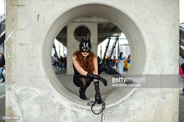 A cosplayer dressed as catwoman poses during a cosplay contest at the Romics event a comic book and gaming convention on April 9 2016 in Rome / AFP /...