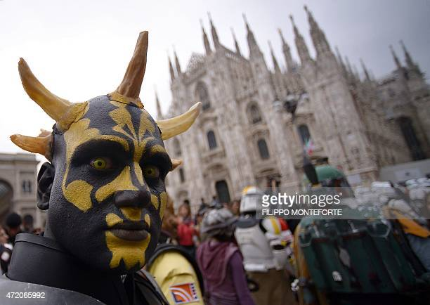 A cosplayer dressed as Darth Maul of 'Star Wars' stands in front of Milan's Duomo on May 3 2015 as part of Star Wars Day AFP PHOTO / FILIPPO...