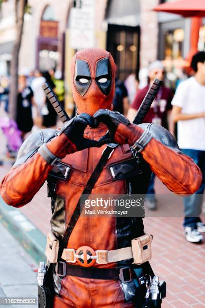 Cosplayer dressed as Deadpool attends the 2019 Comic-Con International on July 18, 2019 in San Diego, California.
