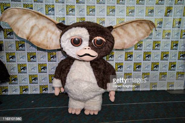 A cosplayer dressed as Gizmo from Gremlins poses at 2019 ComicCon International on July 19 2019 in San Diego California